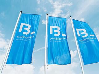 Three Blumenbecker flags in the sky